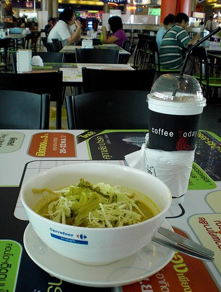 A bowl of Khao Soi noodles (with my usual big iced coffee) - Price? Around $2 for both.