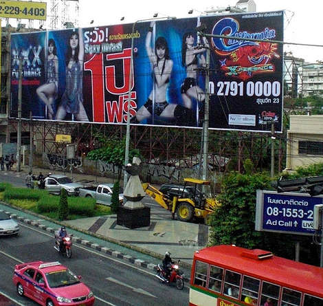 These Bangkok drivers may have been distracted by the billboard of the 'pole dancer'
