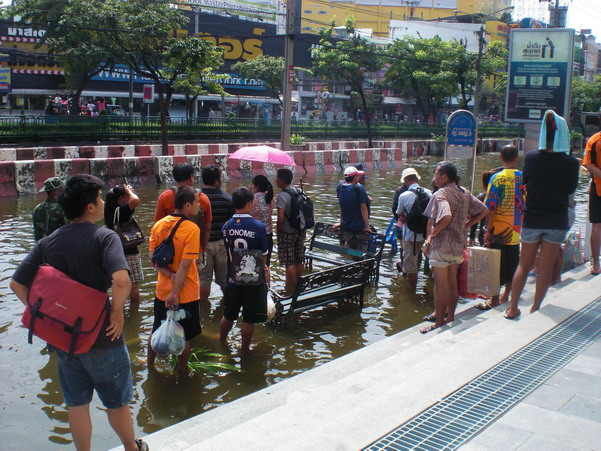 Waiting for the bus at Central Ladprao - yes, in mid-thigh water, buses are still running
