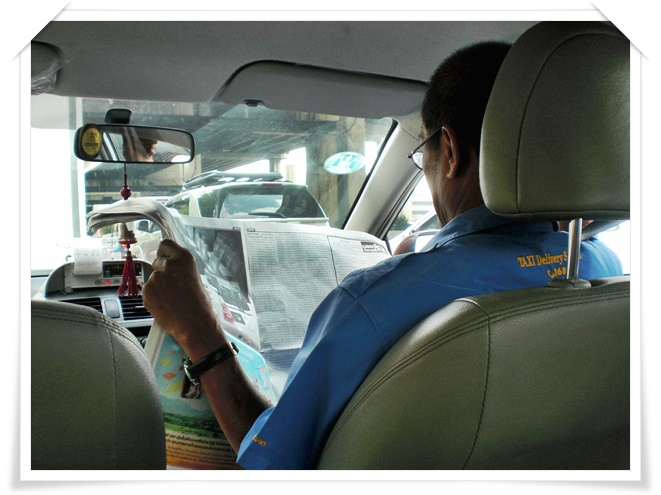 taxi driver reading newspaper